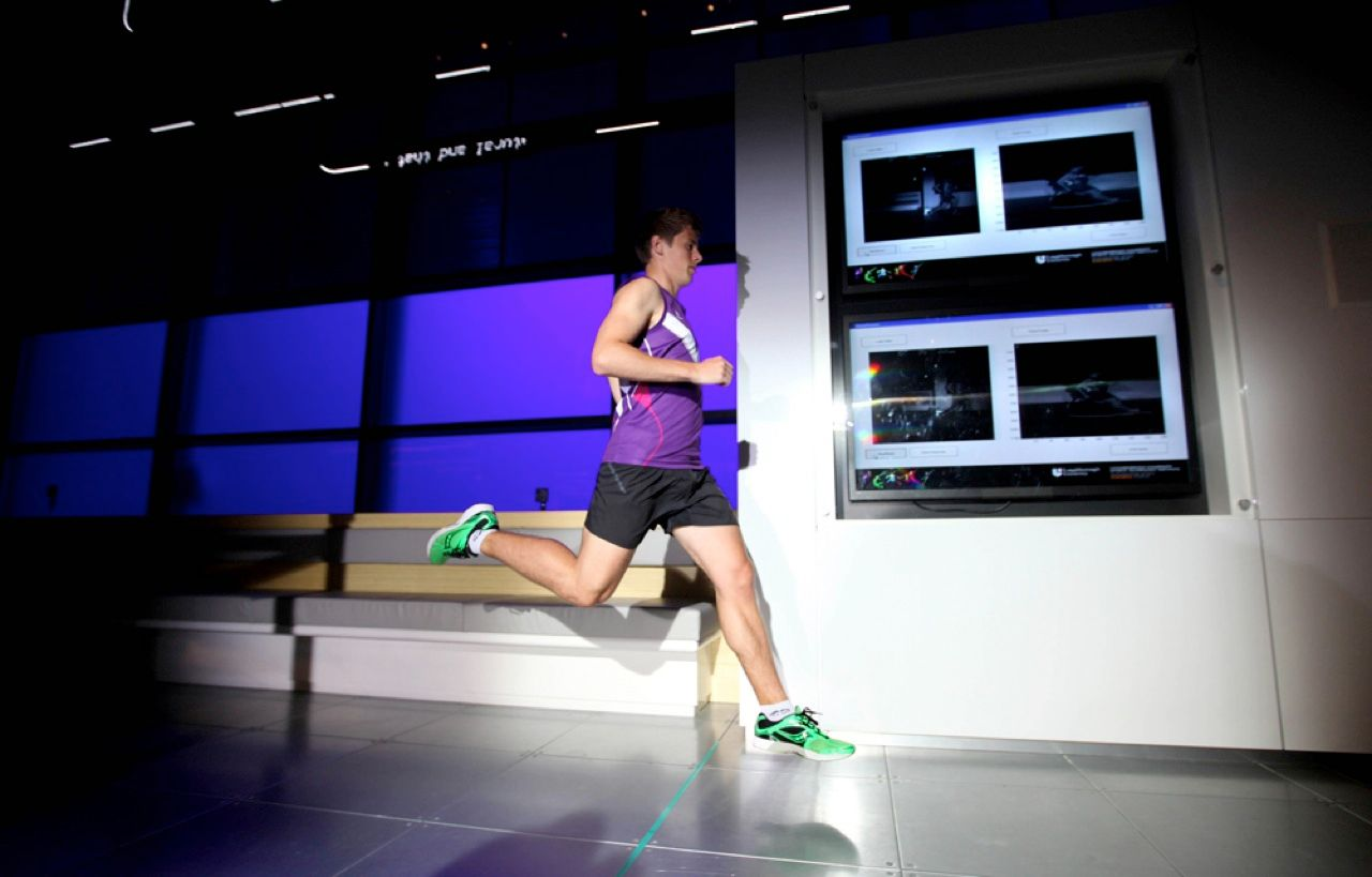 A runner crosses the finish line on an indoor track at the Science Museum of London on 14 August, the first day of the three-day Super Speedy Sprint. The event showed off a technology developed by researchers at Loughborough University, in England, that allows for rapid prototyping of running shoes tailored to a given athlete's biomechanics.