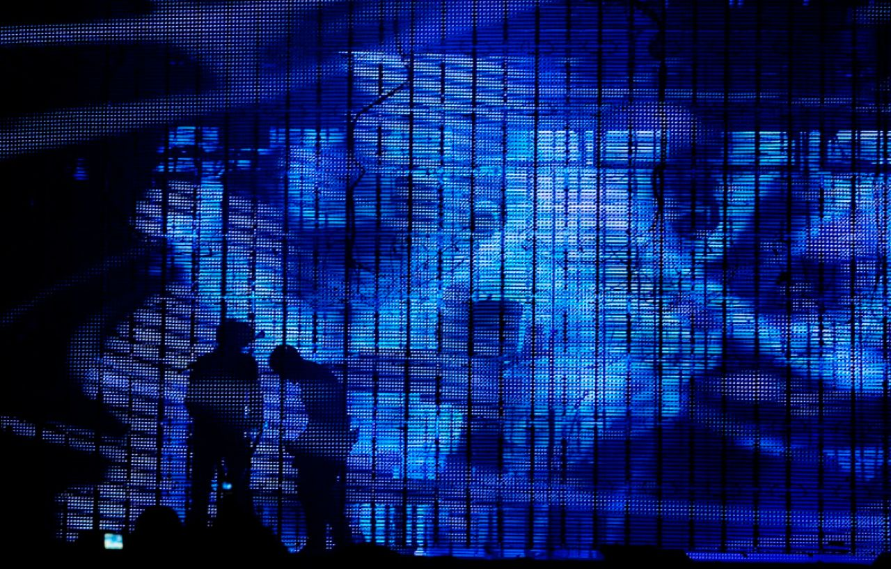"LED F/X: At various points in the show, the band performs behind a transparent or ""stealth"" screen of LED pixels. Pixels on the front screen are selectively illuminated to create visual effects, such as the foglike scene shown here.<"