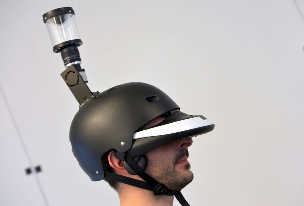 Researchers at INRIA, the French public research center, recently revealed the first wearable gadget that gives humans eyes in the back of their heads. The helmet-mounted prototype, called FlyVIZ, increases the wearer's field of view from 180 degrees to 360 degrees. The team developed a processing algorithm that transforms images captured by a panoramic video-camera system (the bit that sticks up from the crown of the helmet) so that the head-mounted display can show it all.