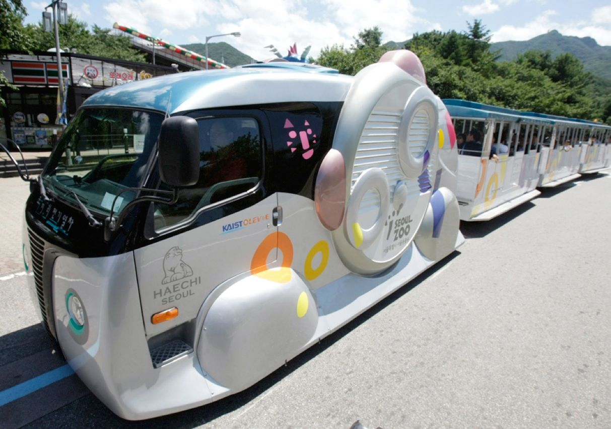 This online electric vehicle, or OLEV, produced by the Korea Advanced Institute of Science and Technology made its debut in July at the Seoul Grand Park in Gwacheon, South Korea. The locomotive, which tows three passenger cars, uses electromagnetic induction to get energy from a blue charging strip in the center of the roadway.
