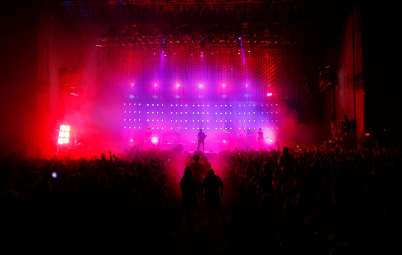 THREE-SCREEN LED SHOW: On stage, three screens of light-emitting diodes are used to illuminate the stage and create special effects. The screens contain LED pixels in red, blue, and green; the lights can be flashed in combinations to create colors, including white.<