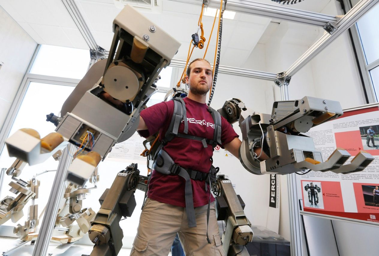 A researcher at the Sant'Anna School of Advanced Studies of Pisa, in Italy, demonstrates an exoskeleton designed to allow a single rescue worker to lift a wall that has fallen and trapped earthquake survivors. The prototype is one of several machines—including a brain-controlled bionic hand and a garbage-recycling robot—that the group has produced.