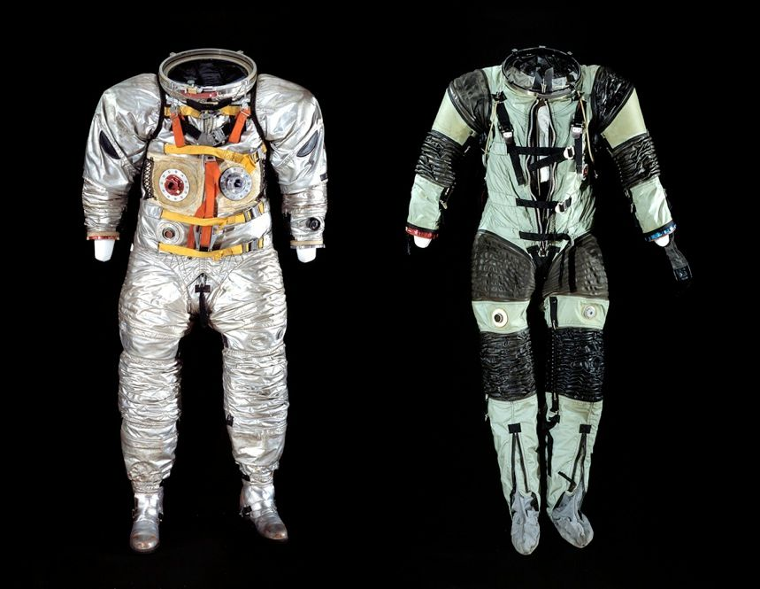 "SPACE SAMPLES: Each suit goes through many iterations until NASA deems it spaceworthy. These two suits [left, from 1963; right, from 1964], housed at the Smithsonian Air and Space Museum in Washington, D.C., were early prototypes of those that Buzz Aldrin and Neil Armstrong eventually wore when they took their famous ""small steps"". <font size=""9"">"