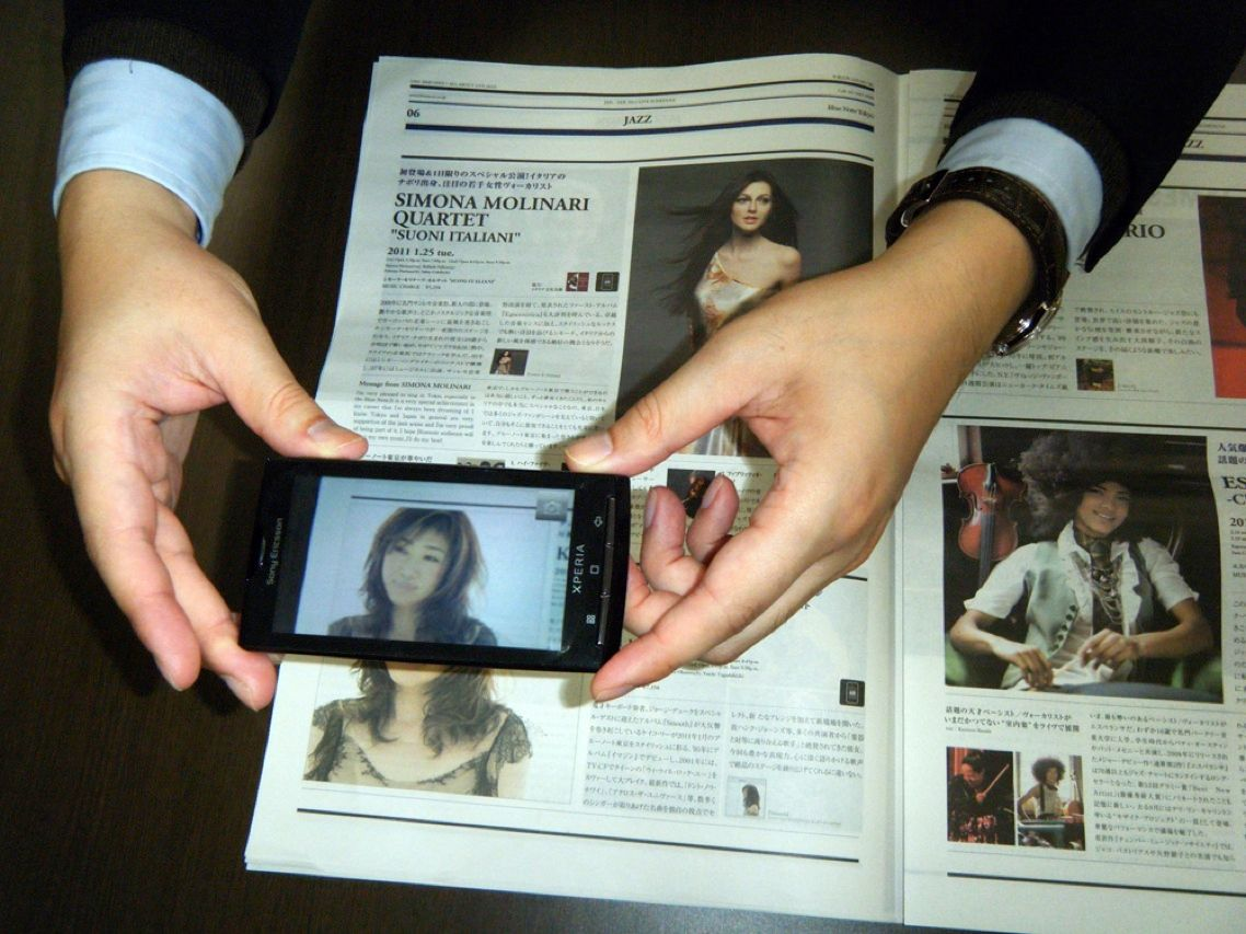 Talk about a rich media experience! Sony Ericsson's new smartphone, the Xperia X10, can snap a picture of an image in a magazine, use image recognition software from NTT Comware to identify a person in your photo, and automatically pull up video in which that person is featured.
