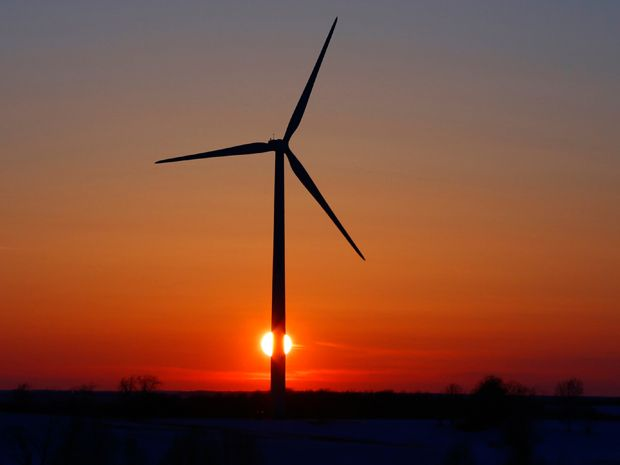 A wind turbine at sunset.