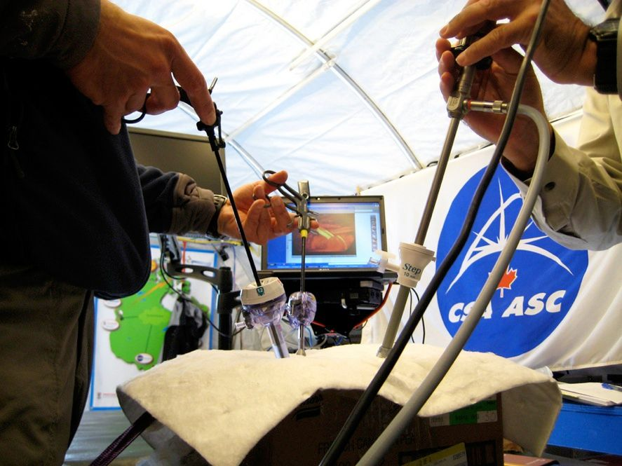 SURGERY AT A DISTANCE: Doctors from the University of Ottawa and the Canadian Space Agency perform a mock appendectomy, guided by doctors in Houston and Detroit on a teleconference. The mock operation is part of the HMP research on telemedicine, which could one day support emergency care for crew members on long journeys.