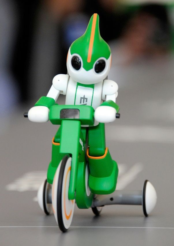 The smallest competitor at this month's Ironman Triathlon, in Hawaii, is the Panasonic Evolta robot. The 17-centimeter-long robot, powered by two AA batteries, is expected to complete the 3.8-kilometer swim, 180-km bicycle ride, and 42-km run in about a week. (Humans, on average, complete the endurance test in about 8 hours.) The robot is running inside a modified hamster wheel and pedaling a bike with training wheels.