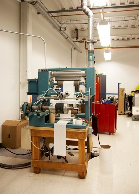 PAPER CHASE: Test-coating equipment spits out rolls of Zink paper.