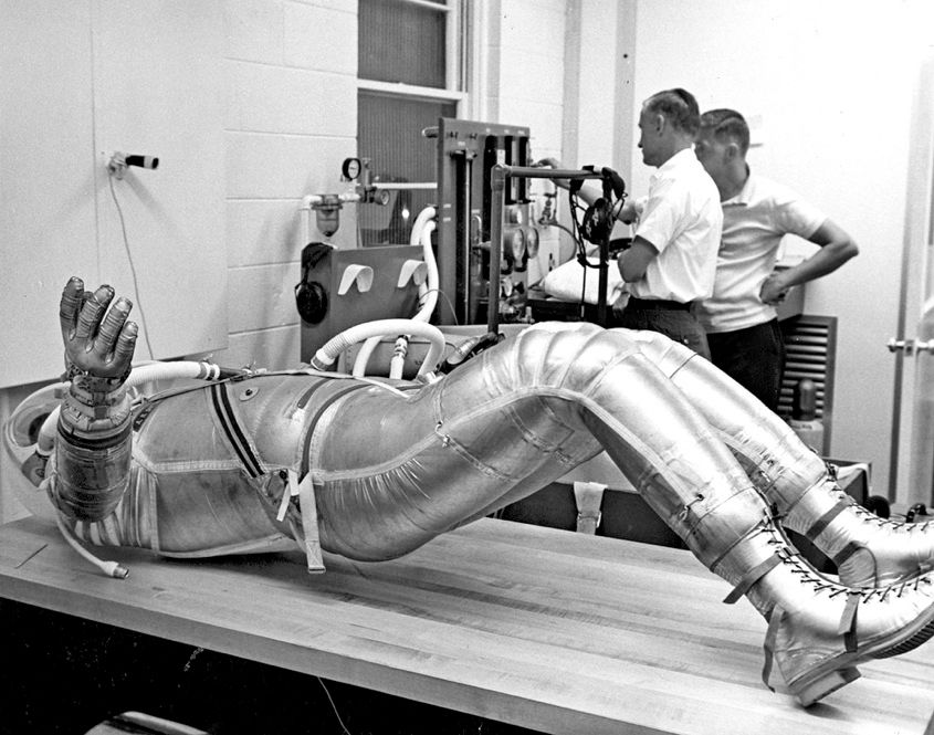 "UNDER PRESSURE: Astronaut Alan Shepard, the first American in space, undergoes a pressure test on his suit. In the last 50 years, the space suit has gone through structural transformations to help it keep pace with changing mission requirements. The space suits that will eventually enable humans to walk on Mars will be a far cry from those the Mercury crew wore. <font size=""9"">"