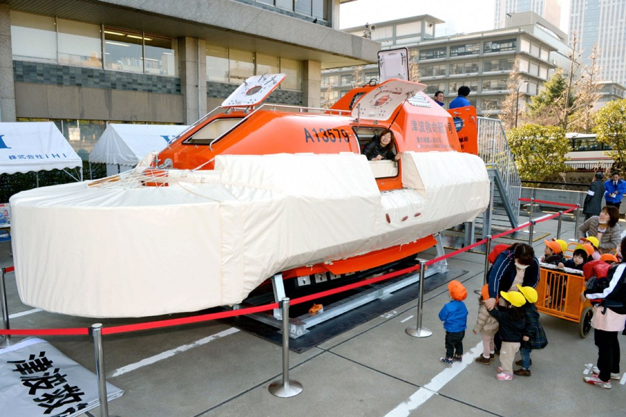 This prototype lifeboat, meant to save residents of coastal areas in the event of a tsunami, was put on display outside the Japanese Transport Ministry, in Tokyo, earlier this month. The boat, likened to Noah's ark, is designed to withstand violent impacts as a result of tidal waves and still remain upright. The 8.4-meter-long vessel, built by IHI Corp. with Japanese government funding, can accommodate up to 35 people for about a week.