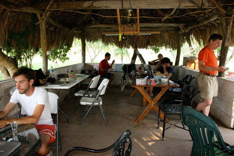 During downtime, team members gather beneath the grass-covered palapa, where they check e-mail, drink beer, play guitar, or just hang out.