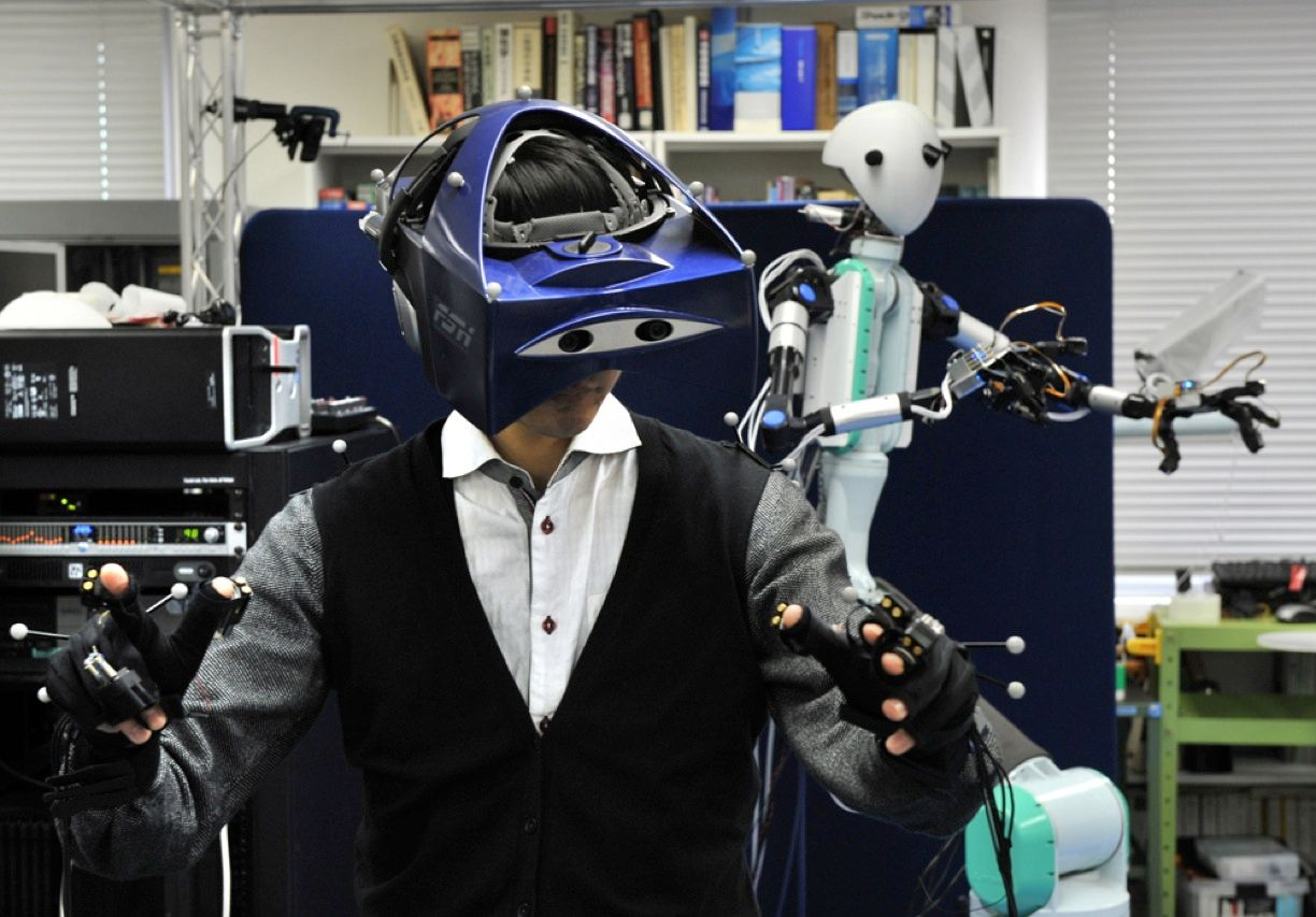 This robot, developed by Susumu Tachi, a researcher at Keio University in Yokohama, Japan, mimics the movements of its human controller. Because the robot allows the controller to see, hear, and feel whatever it experiences, its ability to respond improves continuously.