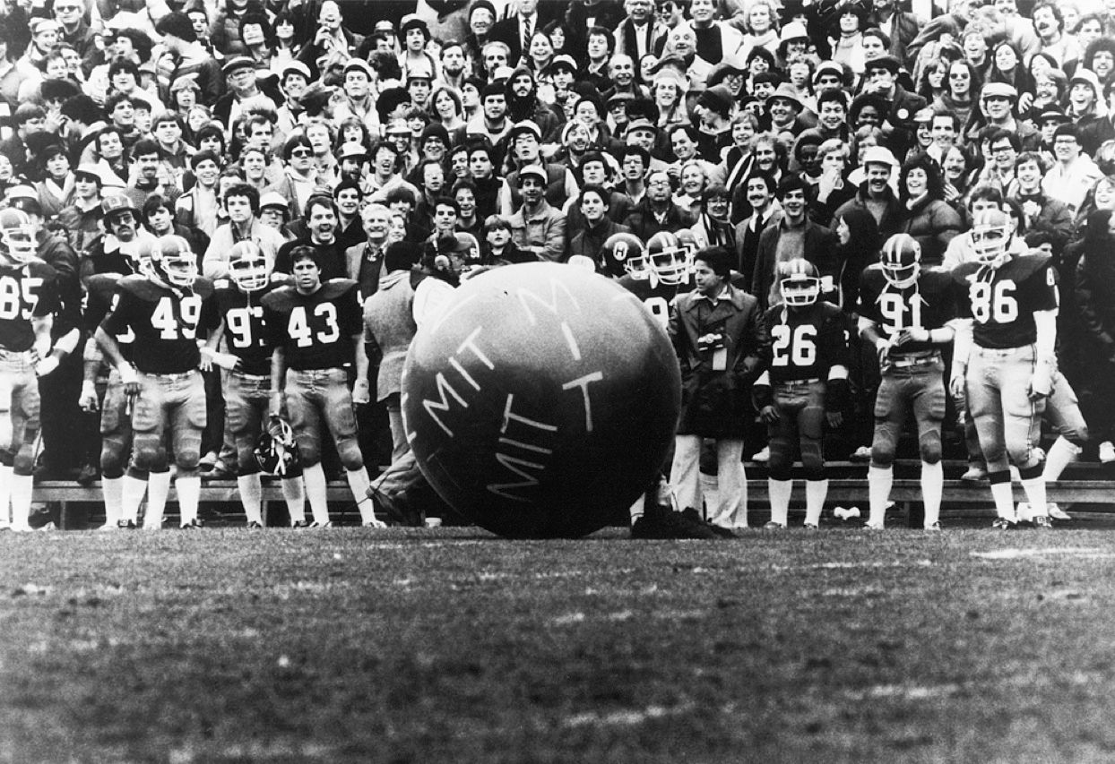 "During the 1982 Harvard–Yale football game, a black weather balloon 2 meters in diameter, with ""MIT"" in large white letters, emerged from midfield and exploded, showering the field in talcum powder. It was only the most spectacular of three pranks that day; none of the groups knew the others had targeted the same event."