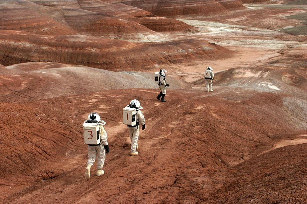 SUIT UP: This is not a Hollywood set, it's the Utah desert. For nearly a decade, scientists and Mars enthusiasts have journeyed to remote places on Earth for insights into what exploration of the Red Planet would be like.