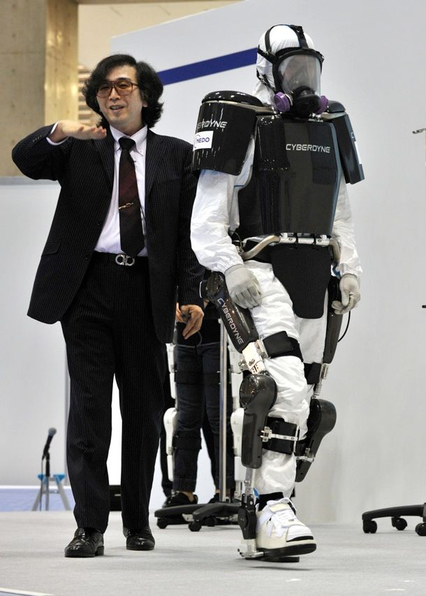 Robotics company Cyberdyne shows off its HAL robot suit, an exoskeleton designed to be worn by rescue, recovery, factory, and health-care workers who do a lot of lifting, and disabled people, who would use the exoskeleton to regain mobility. The 23-kilogram suit moves in unison with the wearer when sensors attached to the skin pick up signals from the wearer's motor neurons.