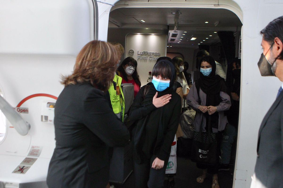 Members of the Afghan Girls Robotics Team leaving aircraft in Mexico