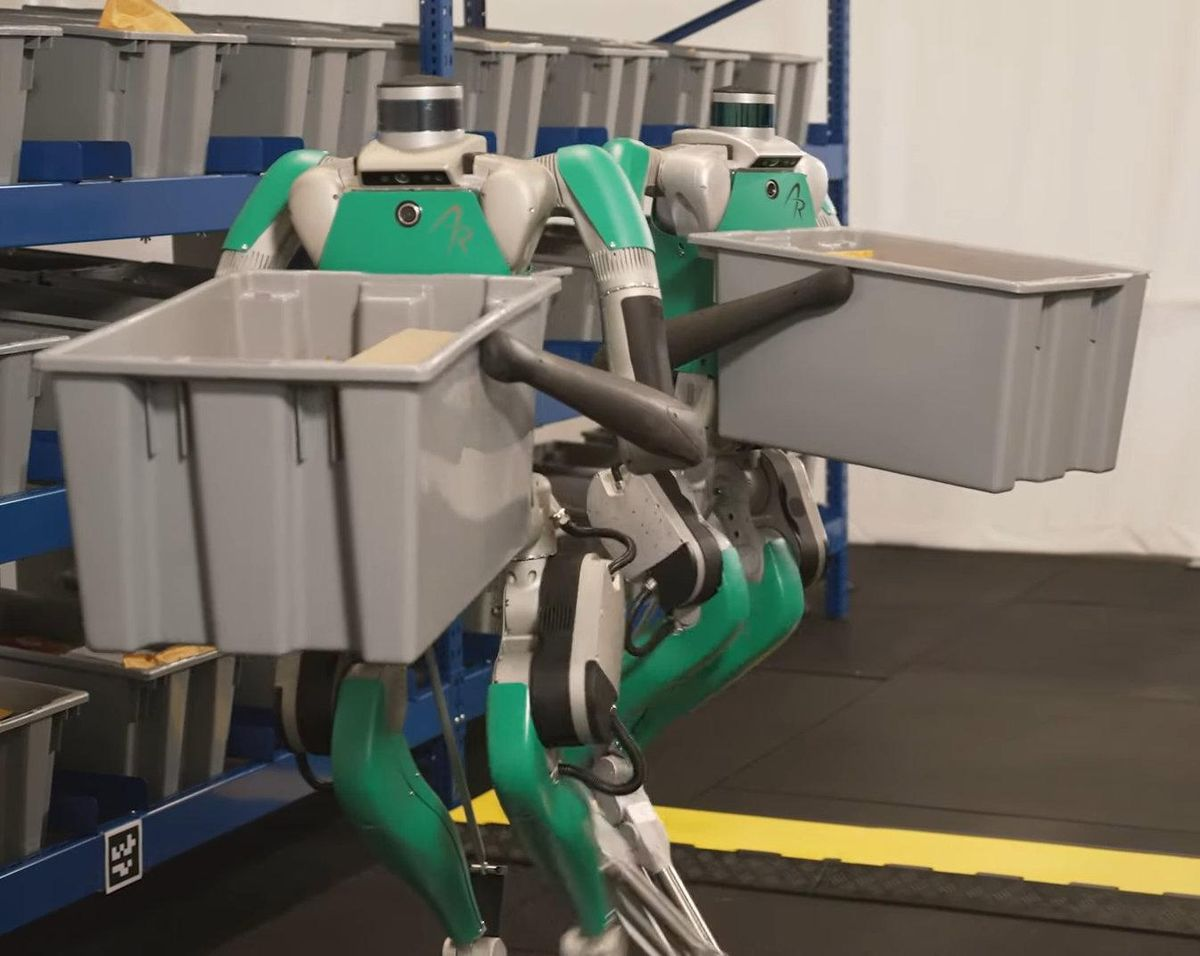Two digit robots working in a warehouse