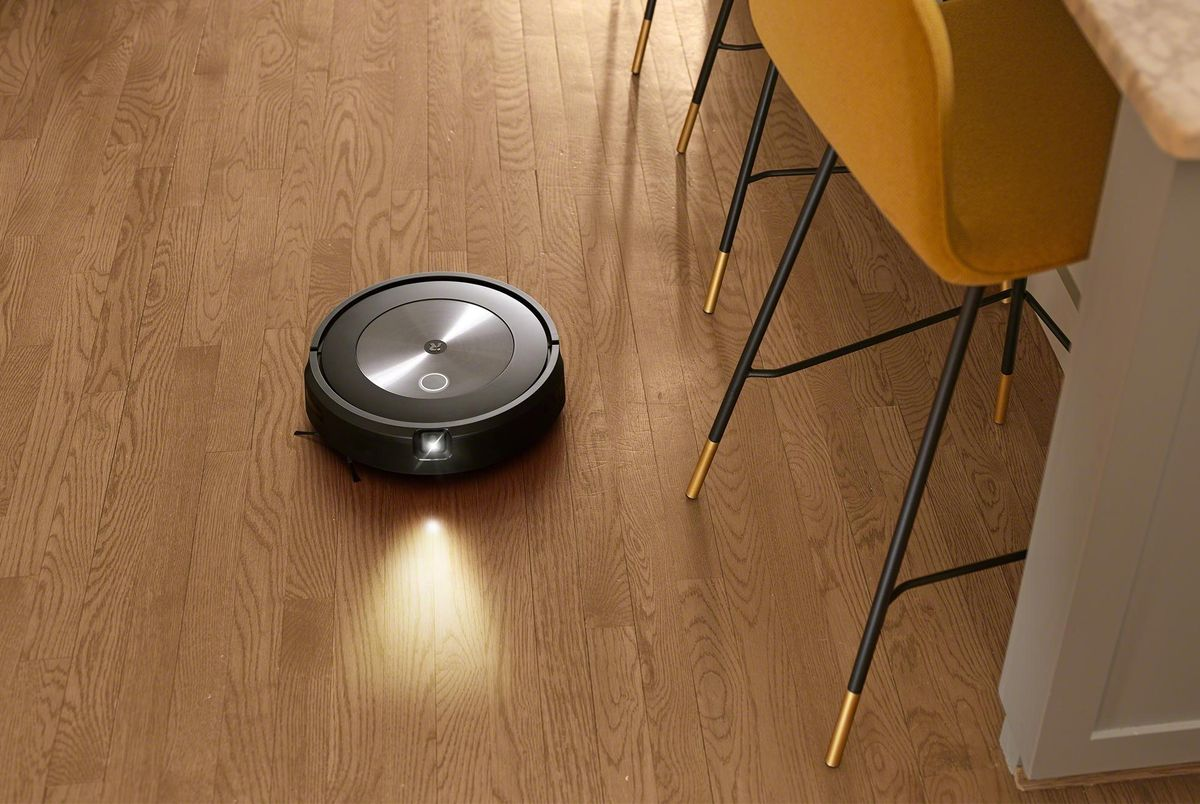 New iRobot j7 with front-facing camera and led light vacuuming a kitchen floor