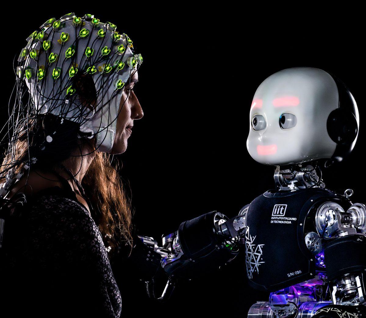 A humanoid robot gazing at a human wearing a sensorized hat