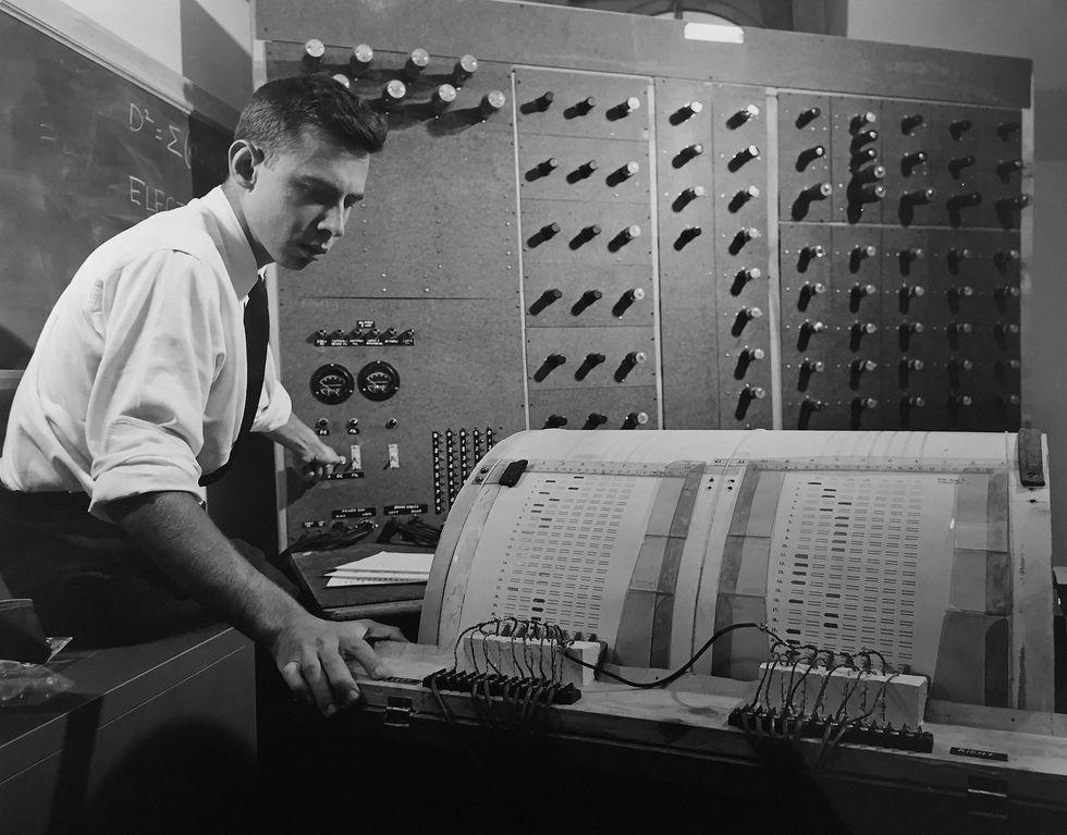 Image of Frank Rosenblatt with the device, perceptron.