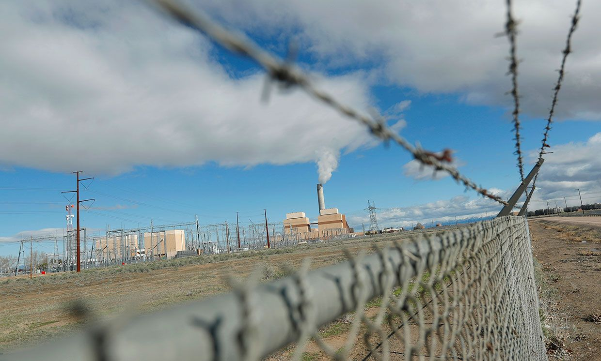 Fencing surrounds the coal-fired Intermountain Power Plant on March 28, 2016 outside Delta, Utah.