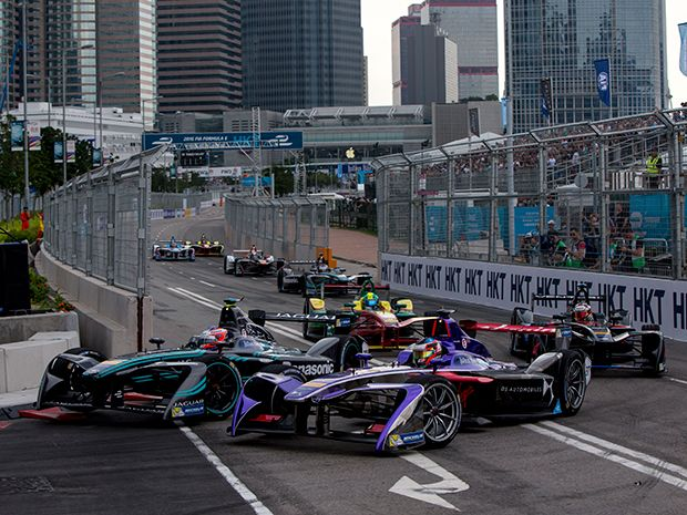 Formula E Season 3 began in Hong Kong. These four cars come around a tight corner.