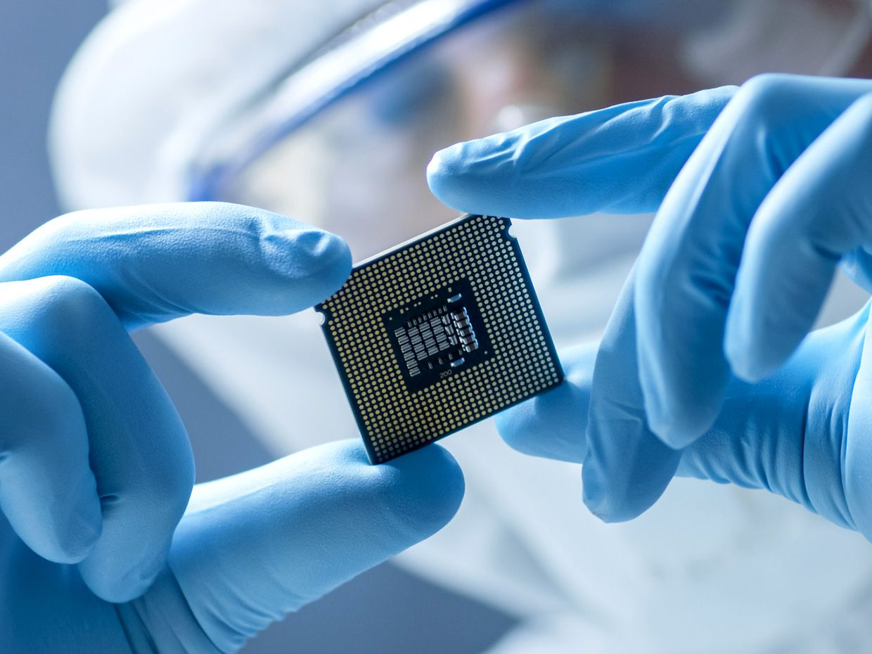 hands holding semiconductor