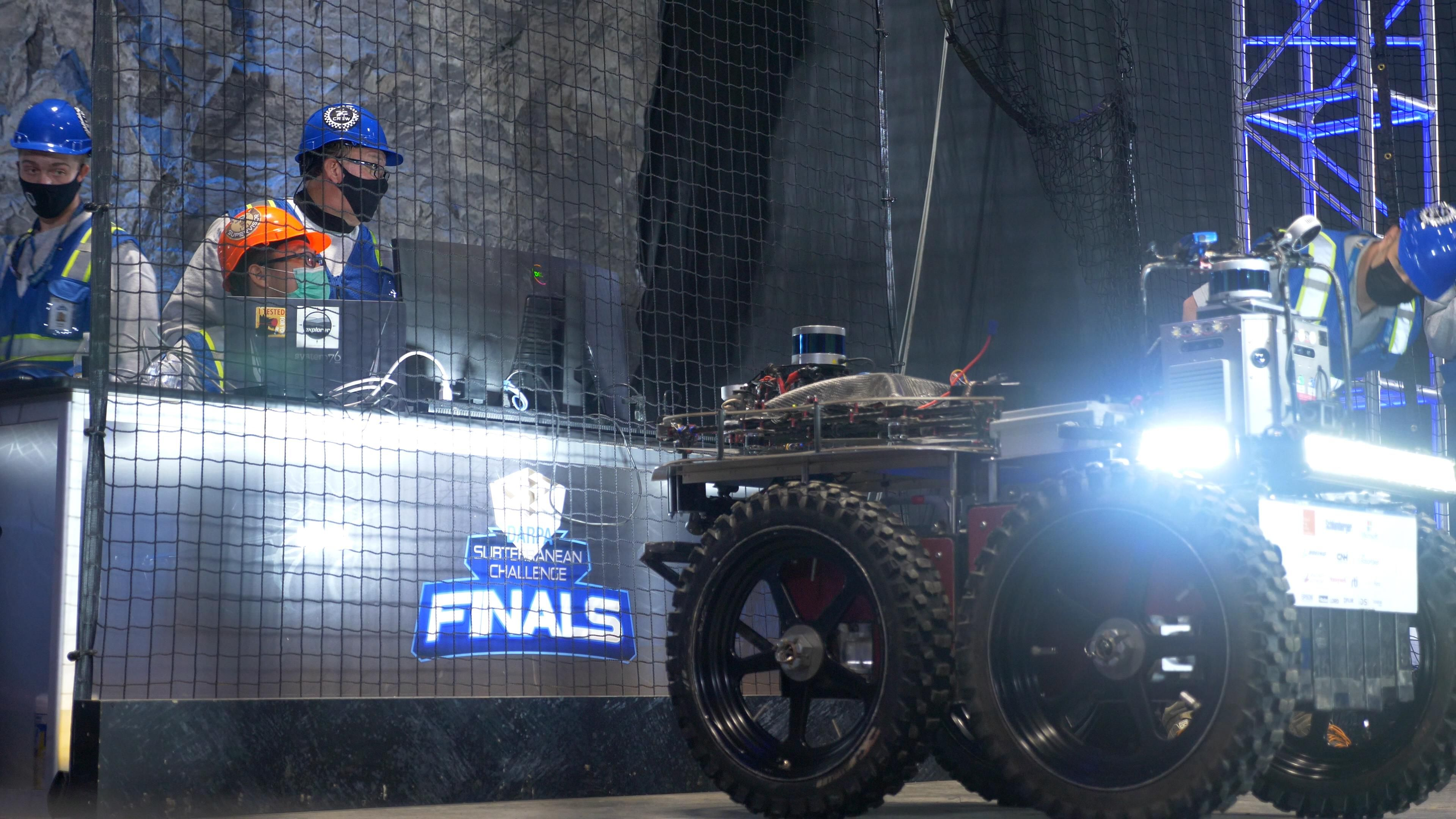 Human operators and a robot during the DARPA Subterranean Challenge Finals