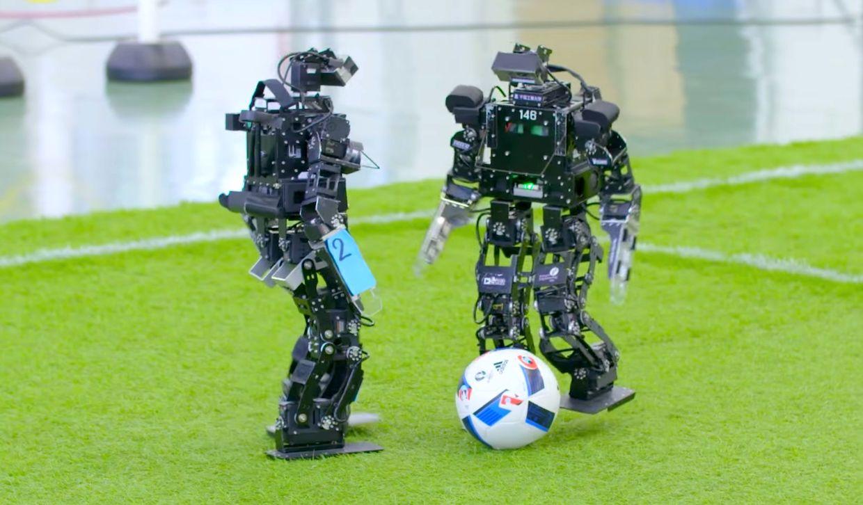 Humanoid robots play soccer at RoboCup