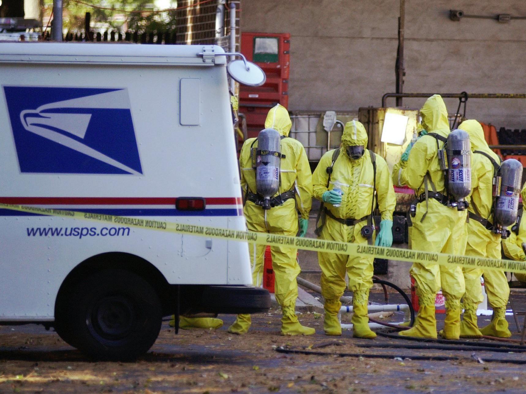 Image of a hazmat team outside a post office.