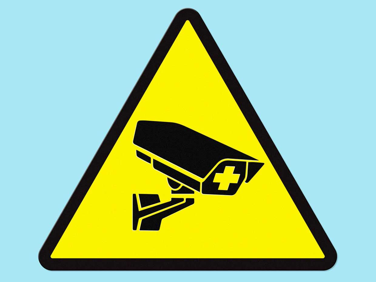 Image of a surveillance camera within a sign.