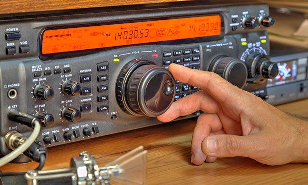 Image of someone adjusting a radio transmitter