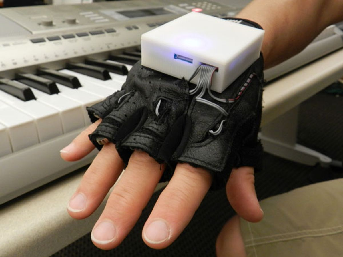 Photo of a hand with wearable computer.