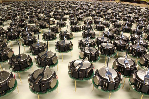 A Thousand Kilobots Self-Assemble Into Complex Shapes