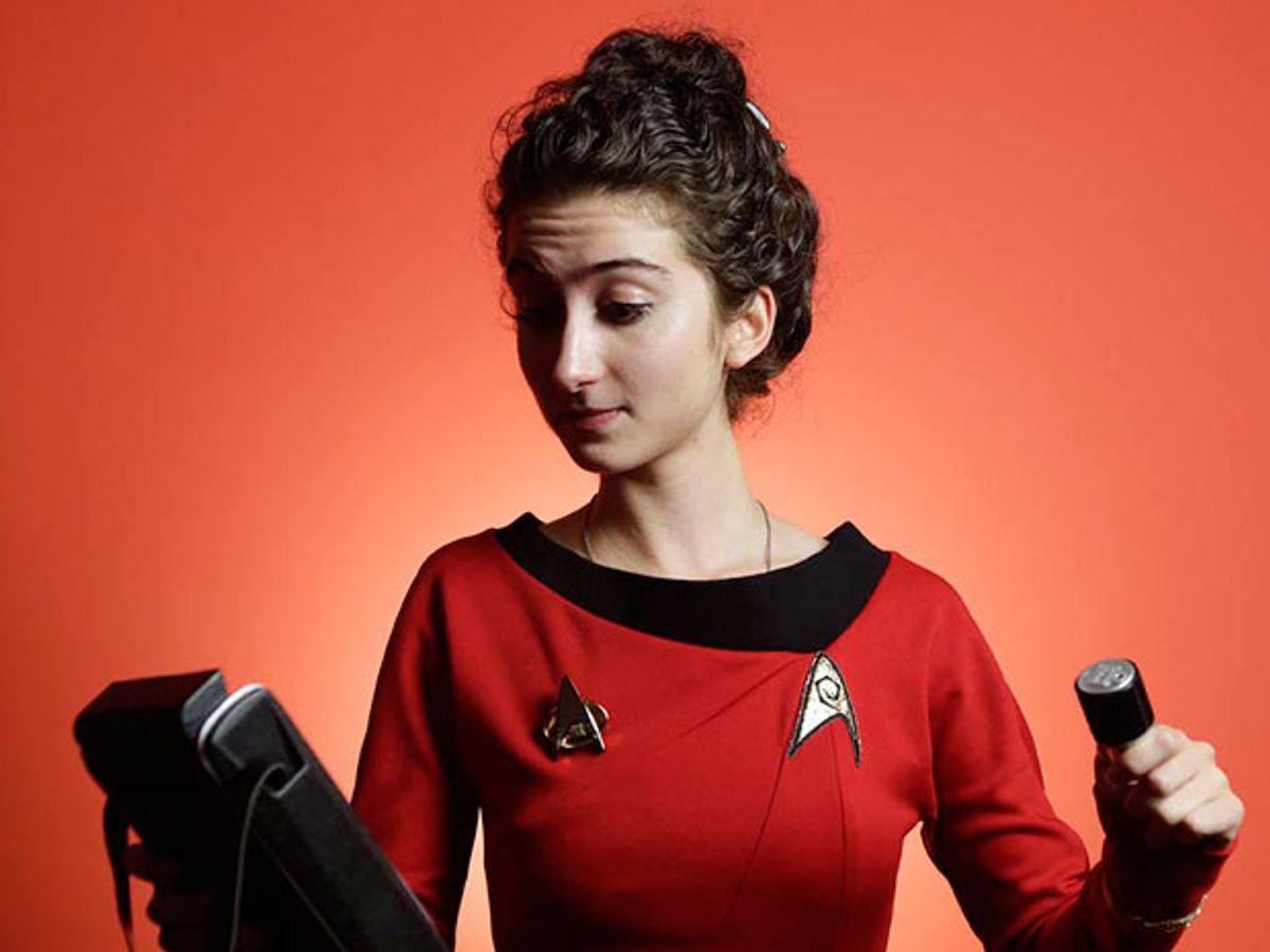 "Tatiana Rypinski, dressed in ""Star Trek"" gear, holds a replica tricorder"
