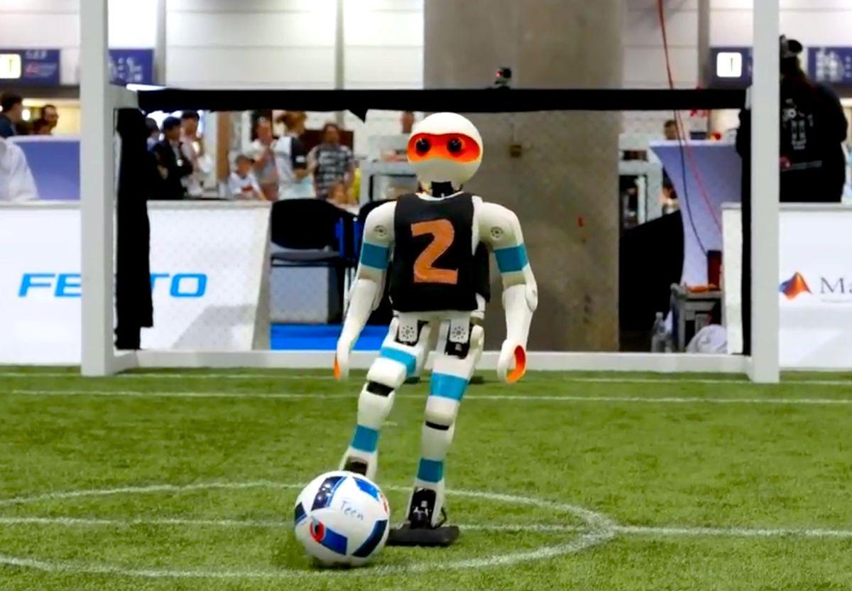 Teen size humanoid robot kicks ball at RoboCup