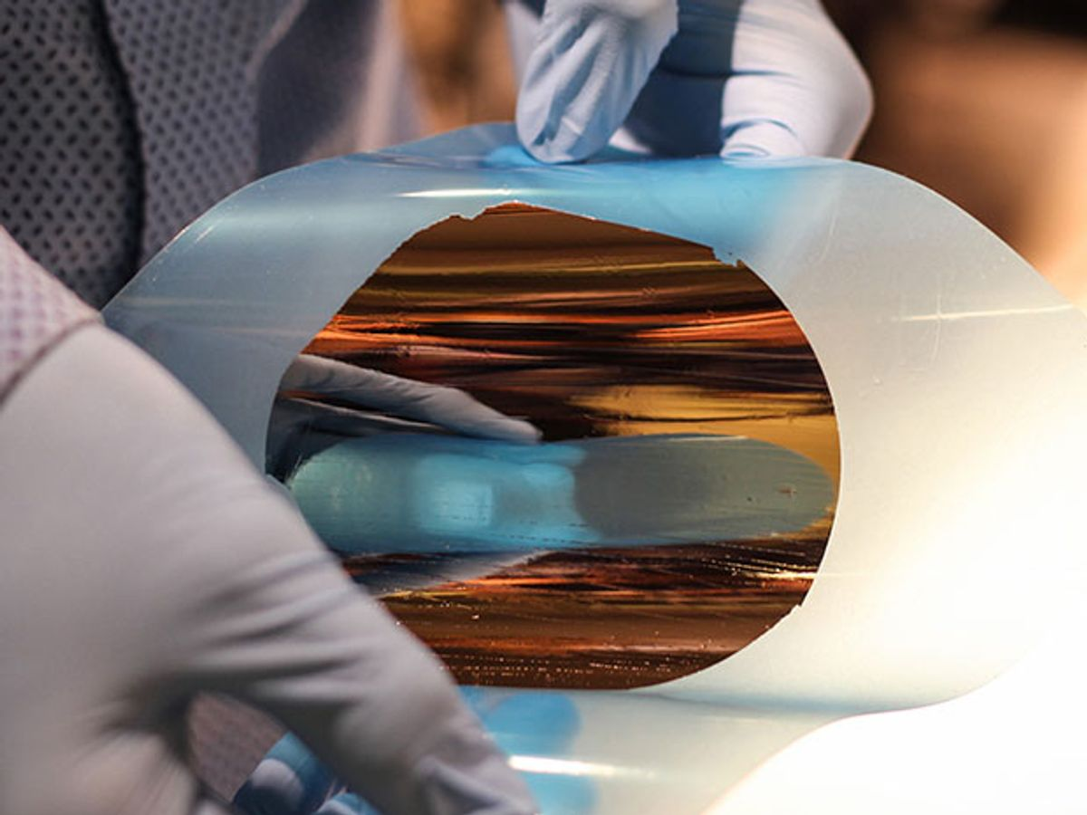 A rubber disk with a reflective copper center