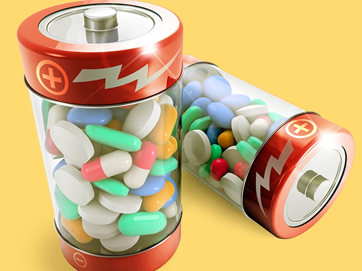 two batteries full of colorful pills on white background