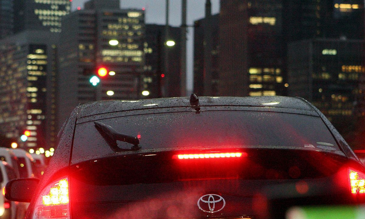 A Toyota Prius hybrid car utilizing its brakes in Tokyo, Japan, on Wednesday, Sept. 8, 2010.