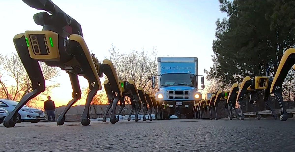 Boston Dynamics' Spot robots pull a truck