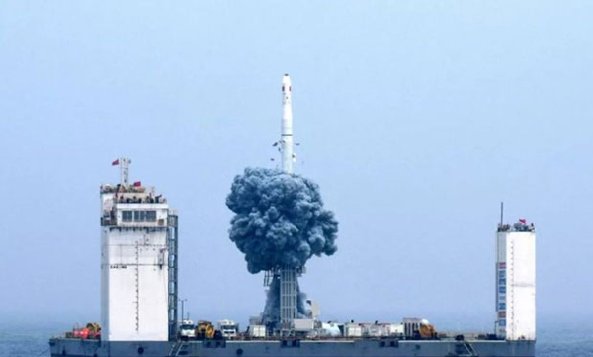 Photo showing liftoff from a mobile platform in the Yellow Sea.