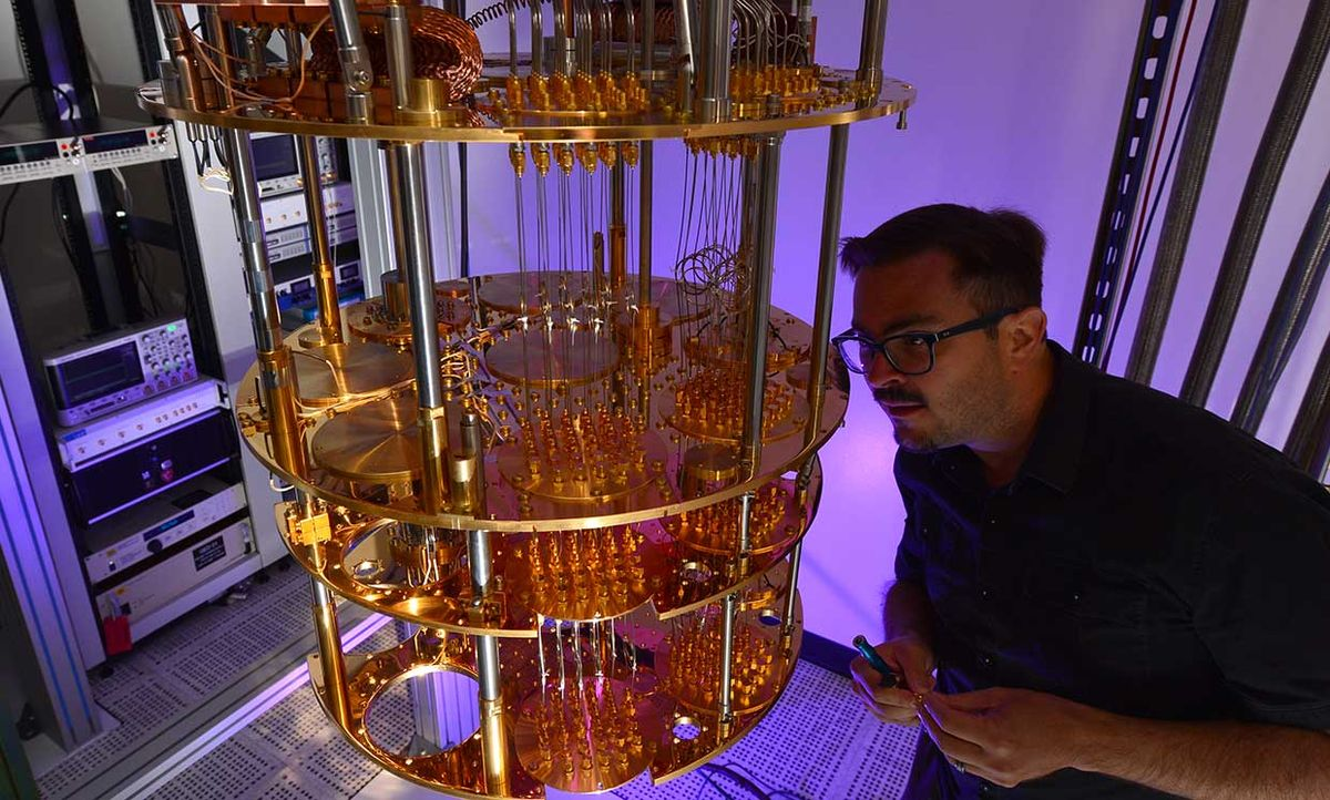Intel quantum computing researcher David Michalak inspects part of a quantum computing system at the company's Hillsboro, Ore., campus.