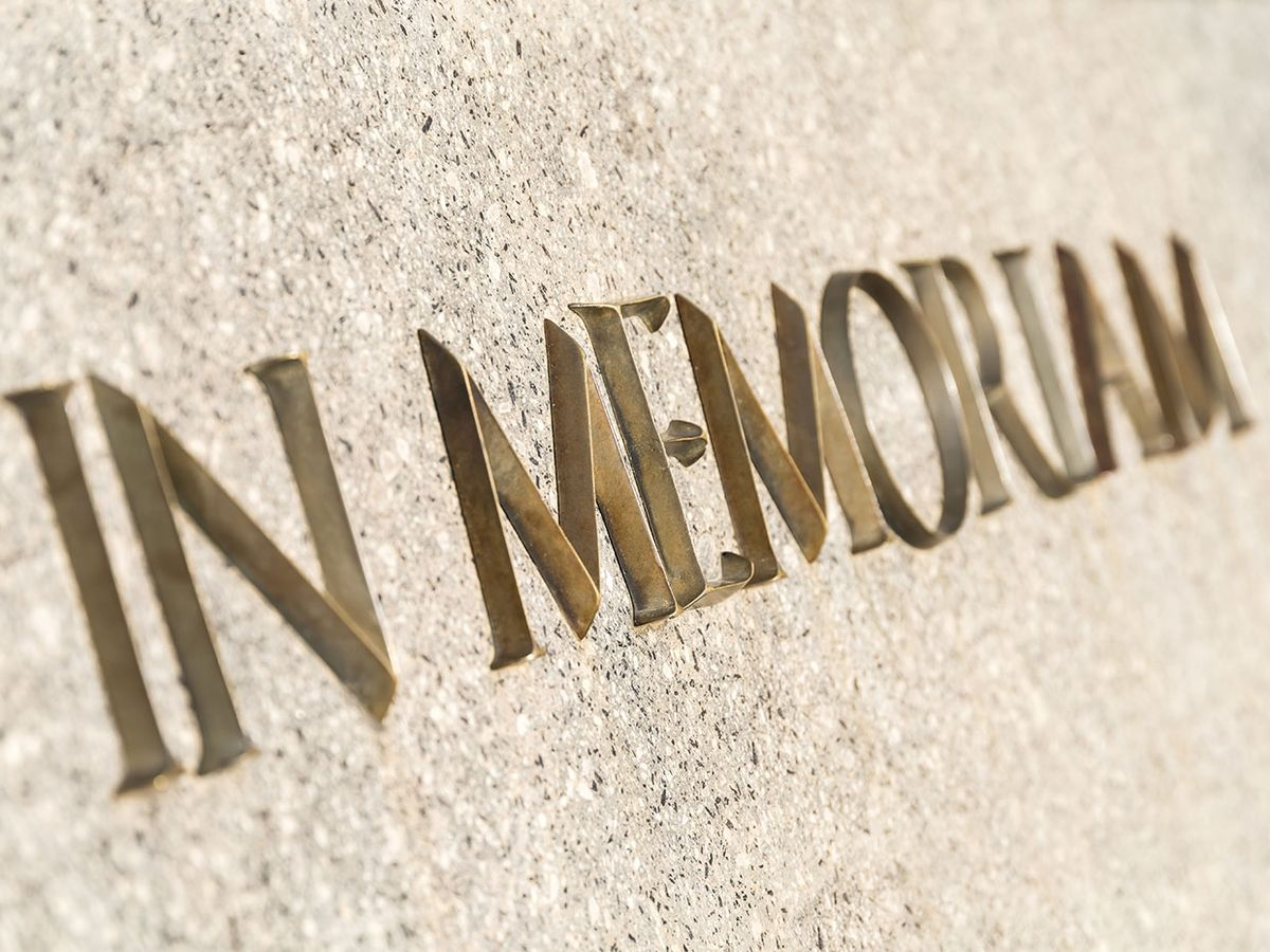The words In Memoriam on a stone surface
