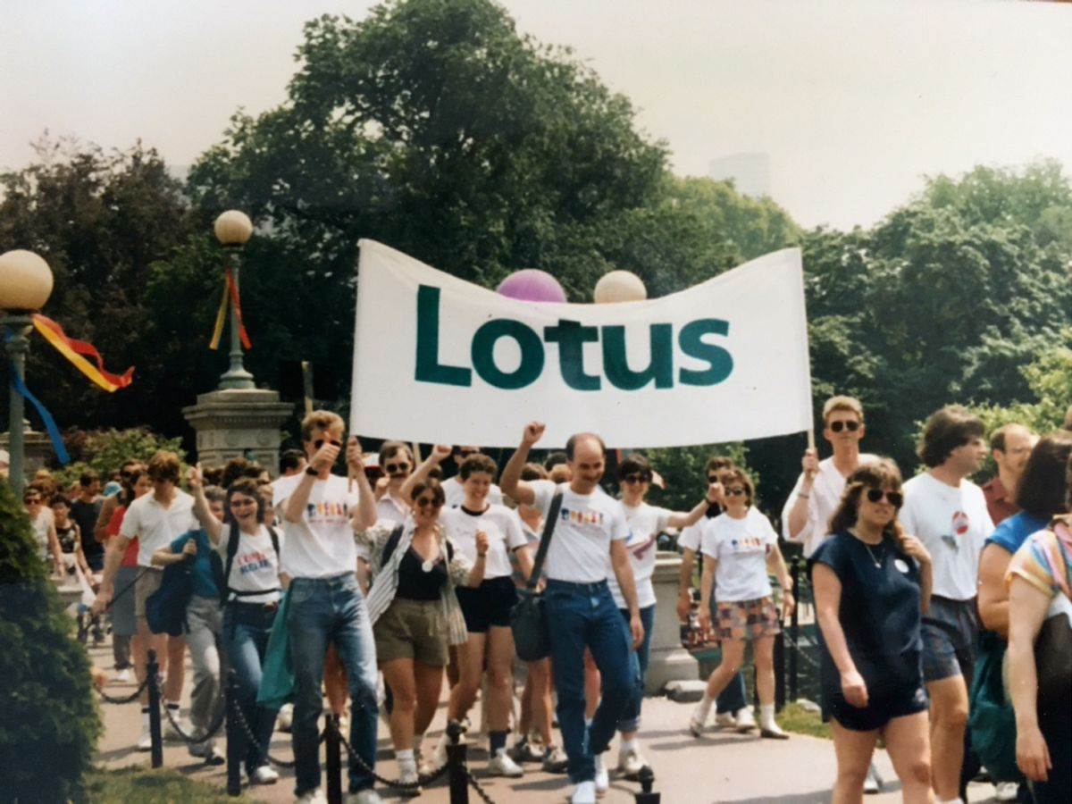 Matt Stern and his Lotus colleagues walk in the first Boston AIDS Walk with a Lotus banner.