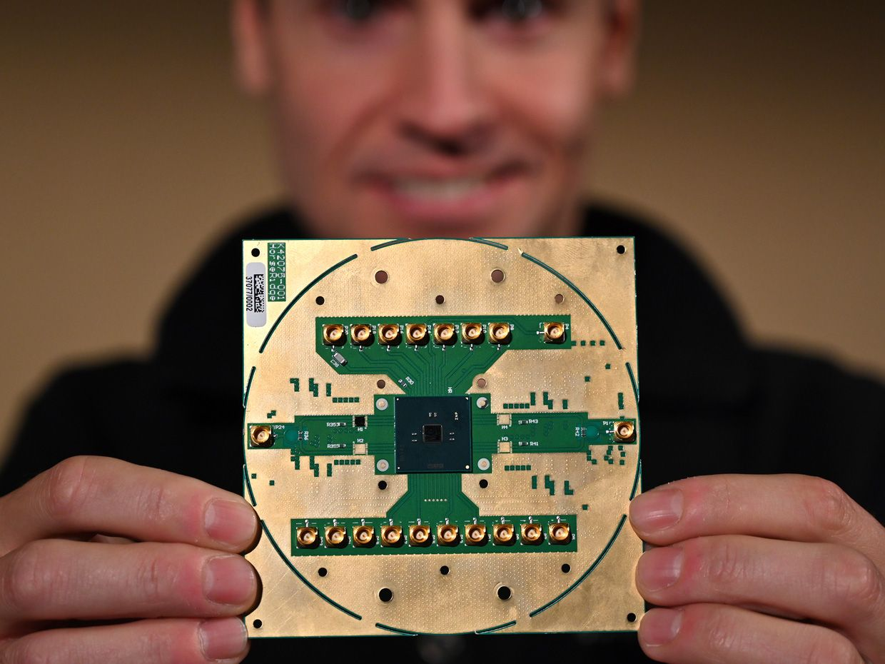 Intel Labs principal engineer Stefano Pellerano holds Horse Ridge, a new cryogenic control chip for quantum computers.