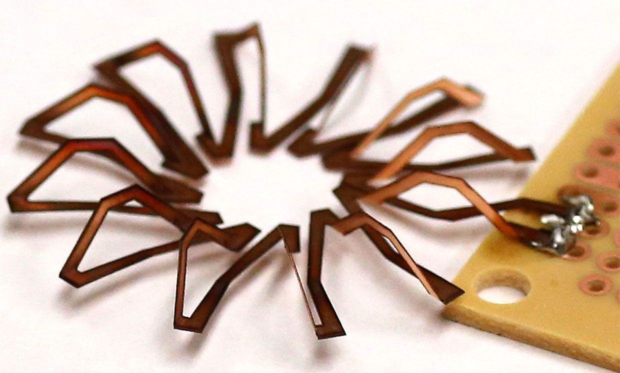 Laser created 12-turn toroid, cut and folded in the process.