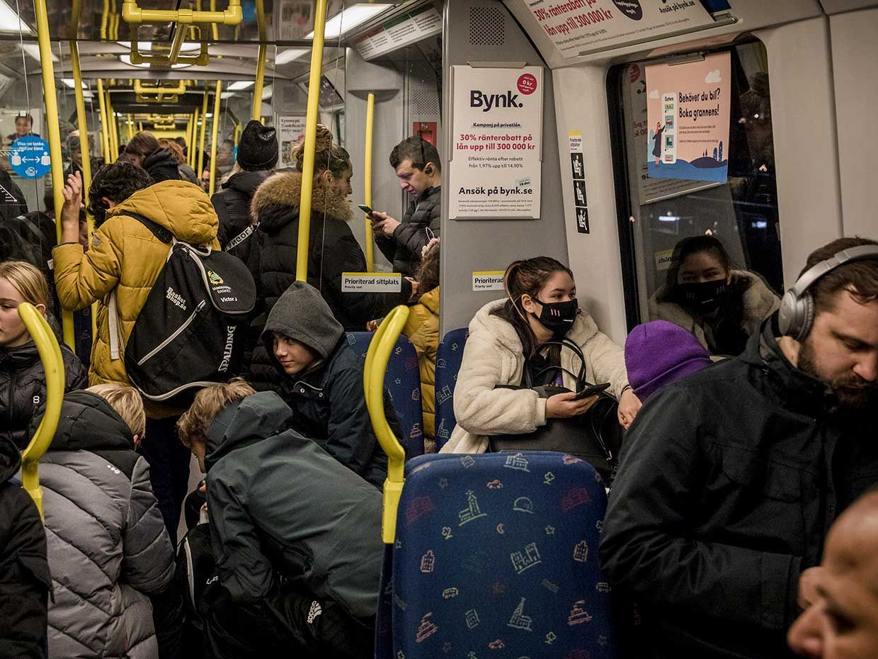 Passengers are crammed into a packed subway car in the middle of the ongoing Covid-19 pandemic, on December 4, 2020 in Stockholm, Sweden.
