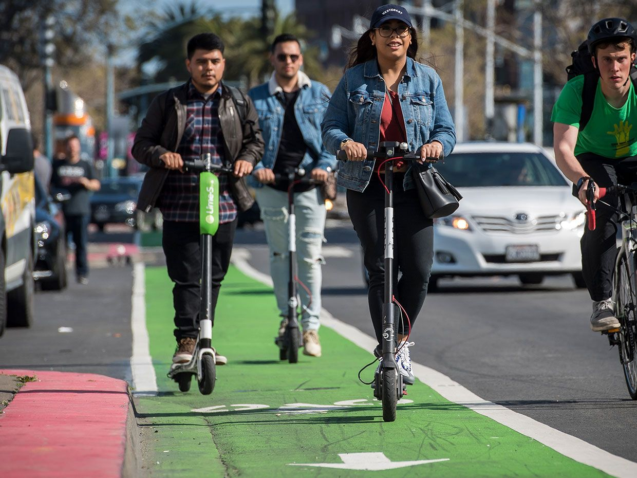 LimeBike (left) and Bird Rides shared electric scooters on the Embarcadero in San Francisco, California, U.S., on April 13, 2018.