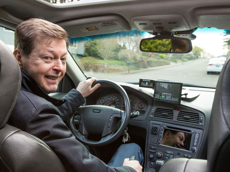 Mats Järlström at the wheel of his car.