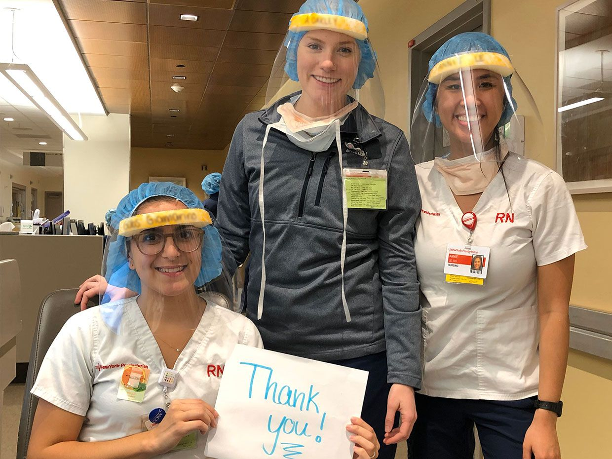Nurses posed for this photo as a thank you to the volunteers that hand-made and delivered the face shields for them.